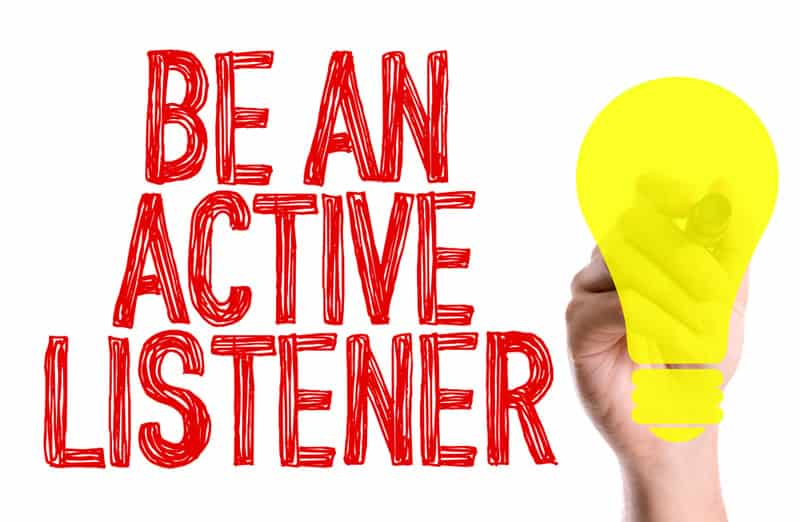 be an active listener graphic hand holding marker