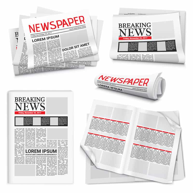 breaking newspapers stacked and rolled